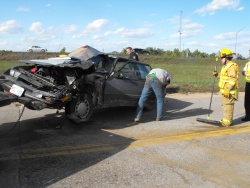 Head-on crash with cement truck wrecks car, leaves driver of car unhurt