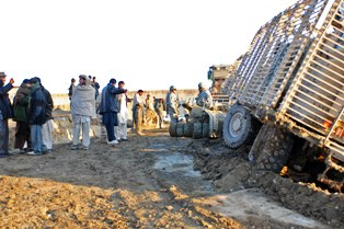 Afghan police, grader operator aid stuck Missouri National Guard vehicles