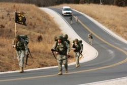 Guard officer candidates learn teamwork in 10-mile road march