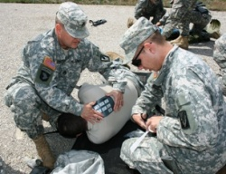 National Guardsman from Dixon studies first aid before deployment