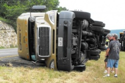 Westbound I-44 briefly blocked at mile marker 165 by overturned semi truck