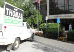 Police order move of prosecutor candidate's campaign truck; selective enforcement alleged